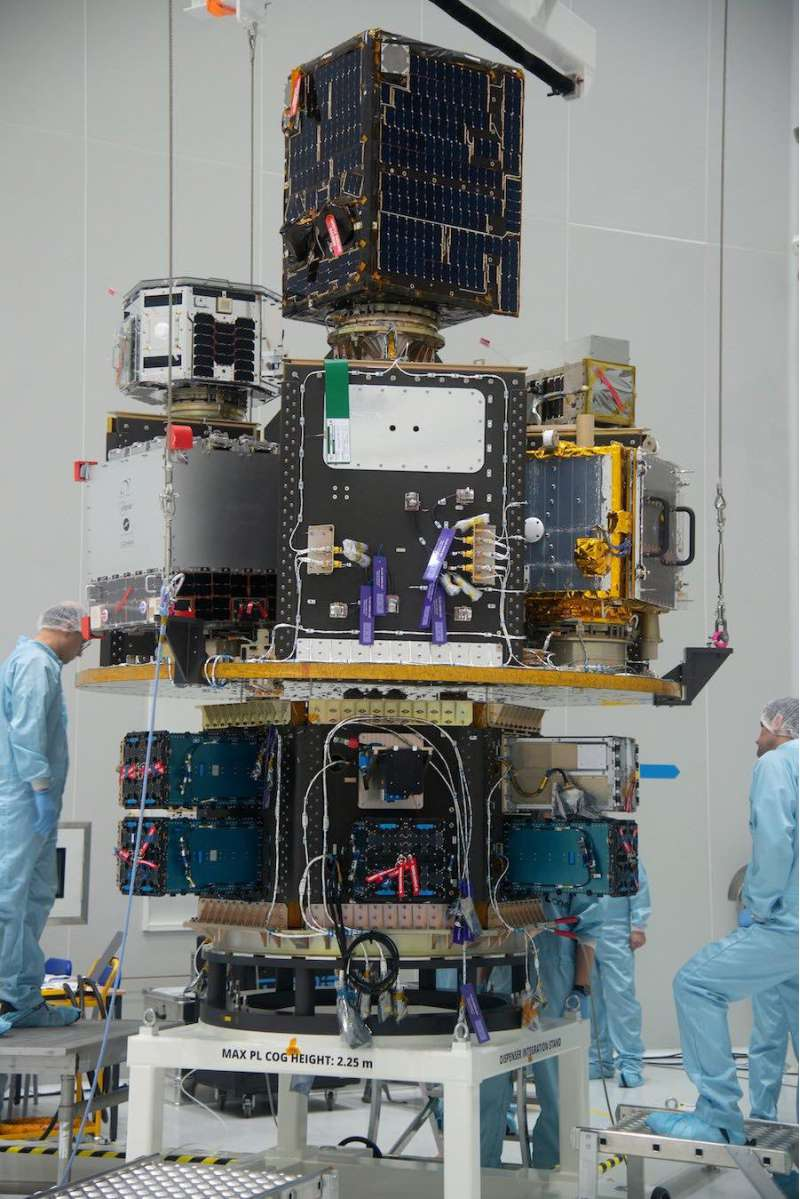Satellites being integrated onto the SSMS payload dispenser pillars