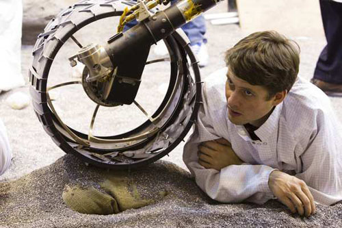 Joseph Carsten watches a test of the Curiosity rover model at Jet Propulsion Laboratory