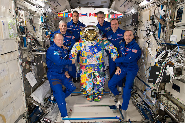 iss exp53 crew victory art spacesuit